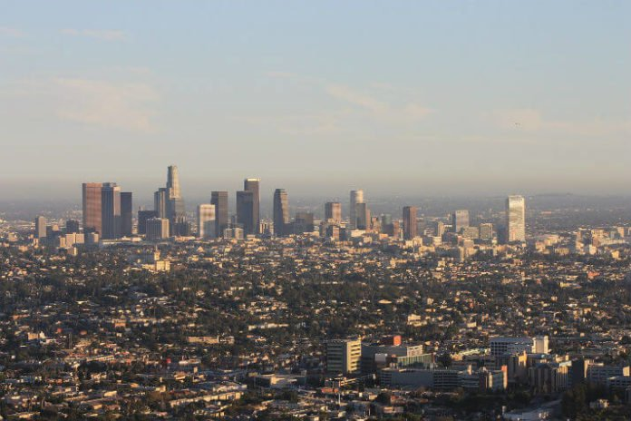 Skyscape Skyslide discounted rate see San Gabriel Mountains downtown LA aerial view