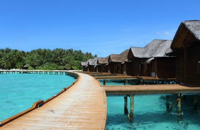 Maldives beach vacation savings Olhuveli Beach & Spa Resort 55% off