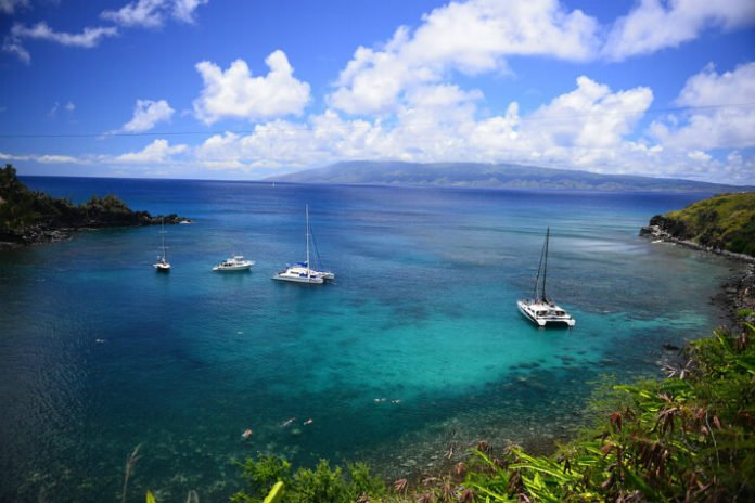Maui vacation sweepstakes win roundtrip airfare hotel stay & tickets to University of Michigan basketball game