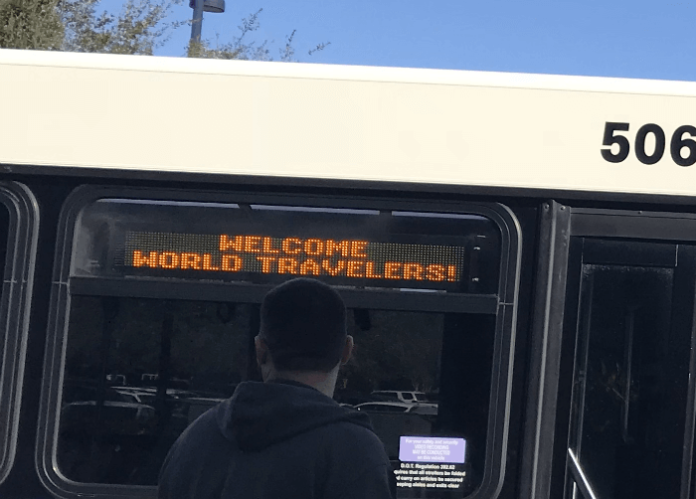 Disney World bus with Welcome World Travelers message
