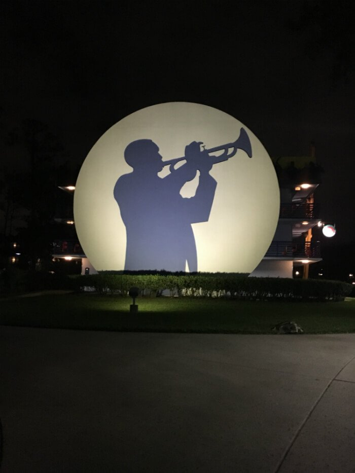 silhouette of trumpet player outside Disney's All Star Music Resort