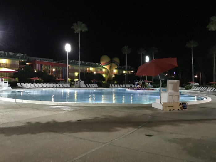 pool, buildings and Three Amigos statue at All Star Music Resort