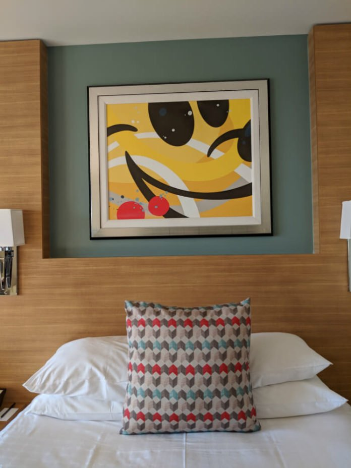 bed and Mickey Mouse painting in Bay Lake Tower villa