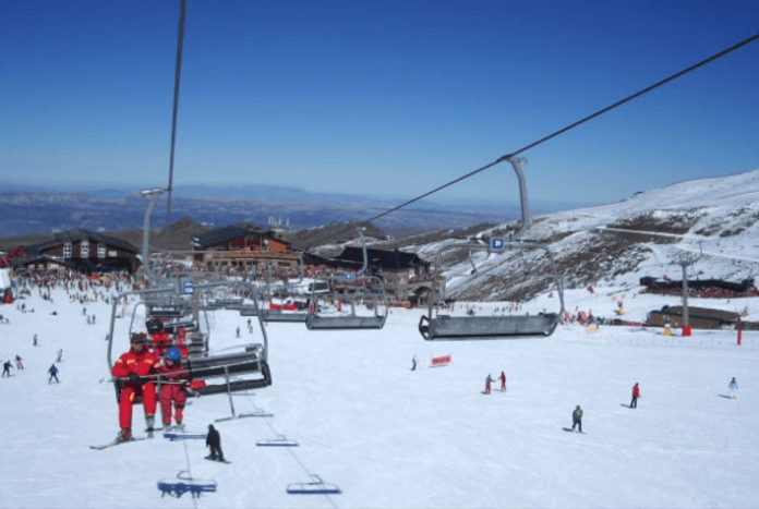 Granada Spain Sierra Nevada hotel close to slopes for cross country downhill skiing & snowboarding discount price