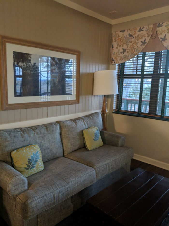 sofa in living room of one bedroom suite in Disney's Hilton Head Island Resort