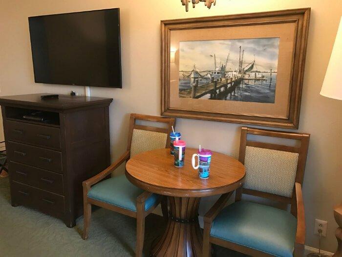 studio in Disney's Hilton Head Island resort, table, Disney mugs, painting, chairs, TV