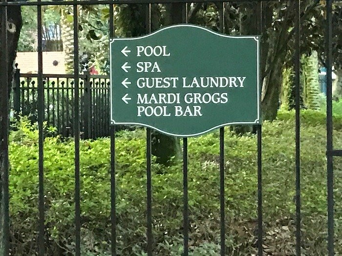 Port Orleans French Quarter sign for pool, spa, guest laundry, Mardi Gras pool bar