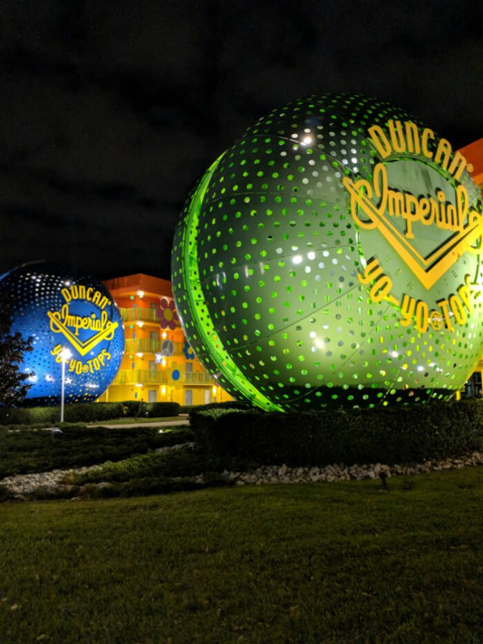 Disney's Pop Century Resort building and giant Duncan Imperial Yo Yo Tops