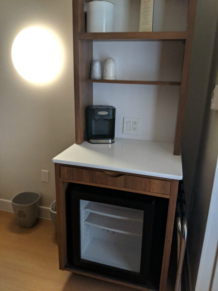 Pop Century hotel room refrigerator, shelves, charging outlets at Disney World resort