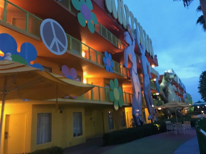 exterior of hotel building at Pop Century resort with peace sign, flowers, happiness, Baloo