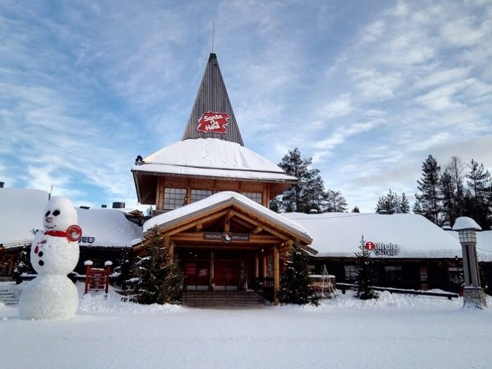 Enjoy Lapland Finland Christmas holiday meet Santa at Santa's Village ski snomobile dog sled reindeer sleigh