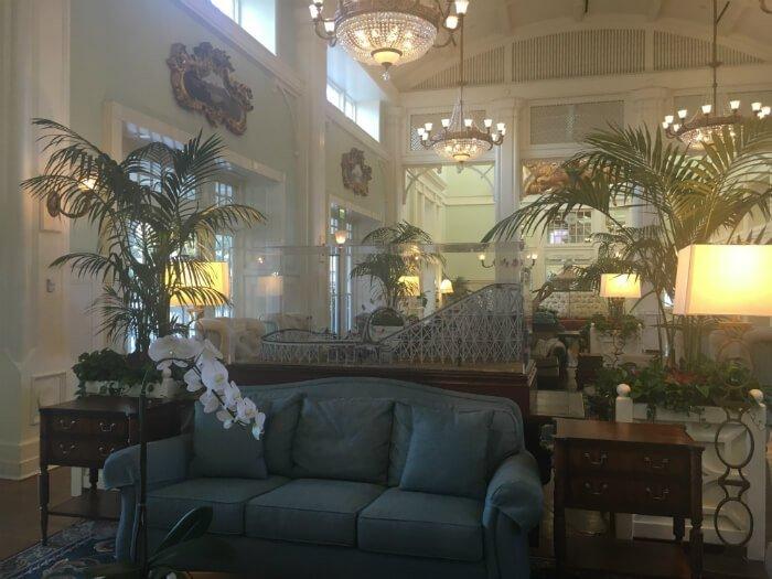 Comfortable sofa beautiful colors & amusement park decorations at Disney's Boardwalk Inn lobby