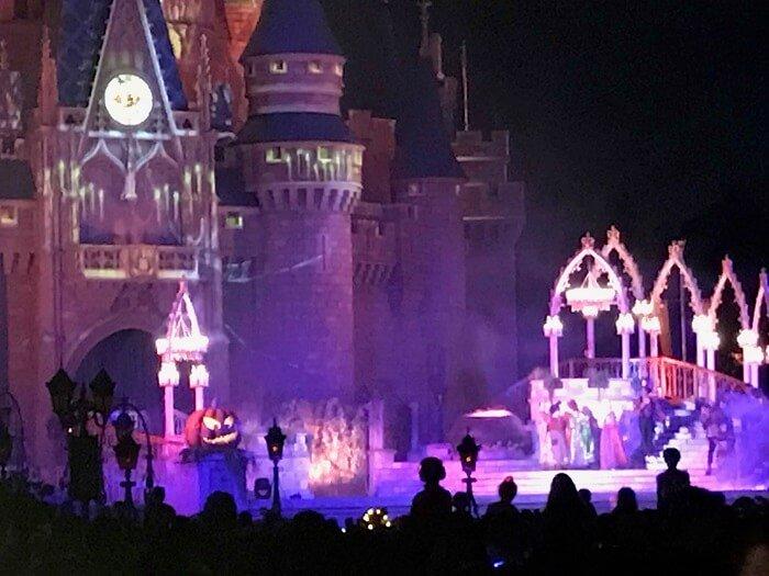 Hocus Pocus Villain Spelltacular in front of Castle in Magic Kingdom