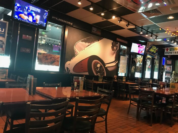 inside Quaker Steak and Lube in Sandusky Ohio with football games on TVs