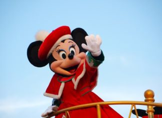 Tokyo Disneyland Christmas parade with Minnie Mouse in red coat