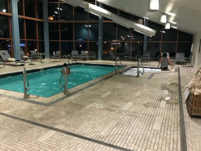 indoor pool and hot tub at night inside Wyndham Grand Pittsburgh Downtown