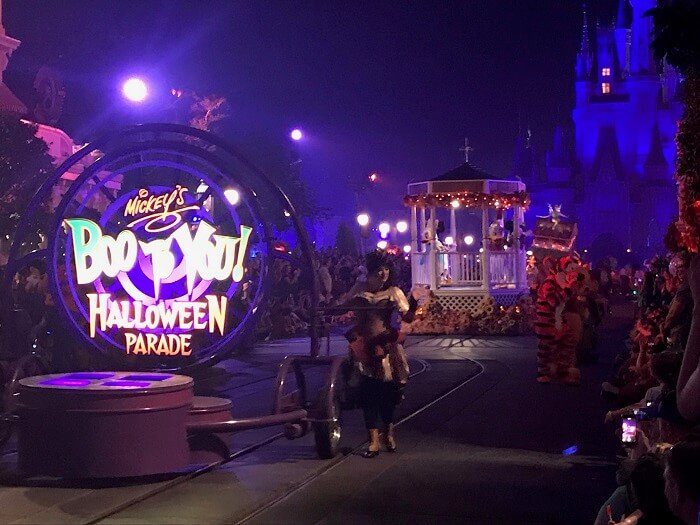 Mickey's Boo To You Halloween Parade beginning float with Magic Kingdom castle in background