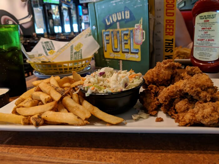 chicken fingers, fries and cole slaw inside Quaker Steak and Lube in Sandusky Ohio