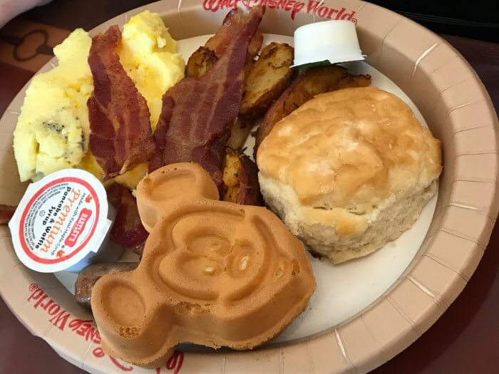 breakfast with Mickey waffle, biscuit, bacon & eggs at Saratoga Springs food court at Disney World
