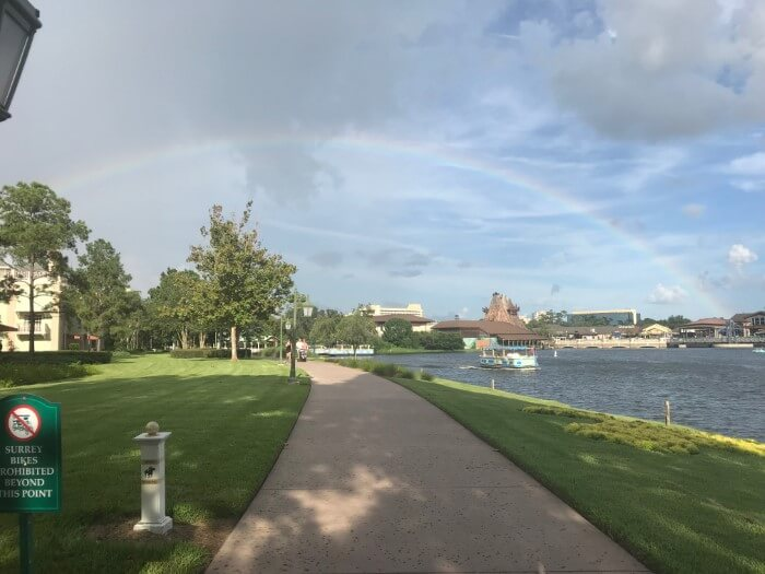 walkway to Disney Springs at Saratoga Springs hotel with rainbow in sky