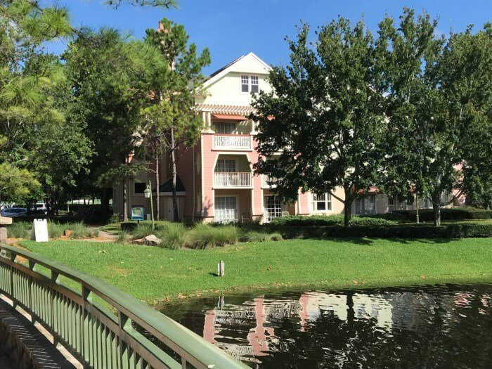 exterior of Saratoga Springs hotel building and lake