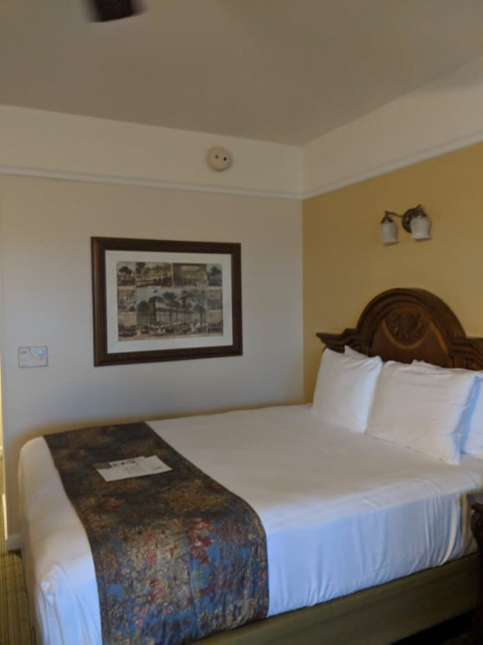 queen bed in Saratoga Springs hotel room in Disney World