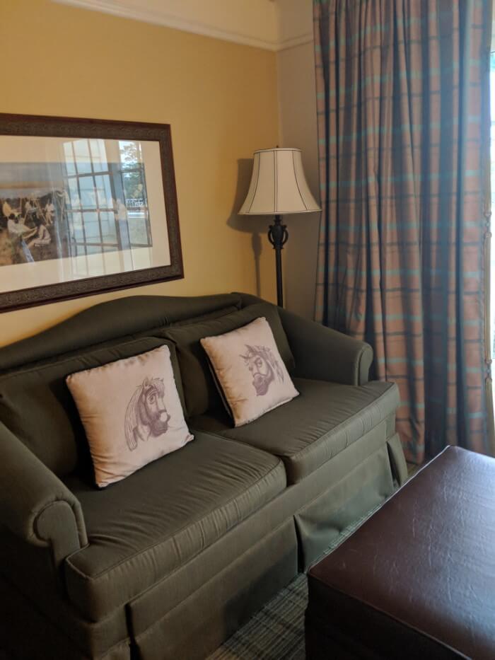 sofa with horse pillows in Saratoga Springs studio villa at Disney hotel