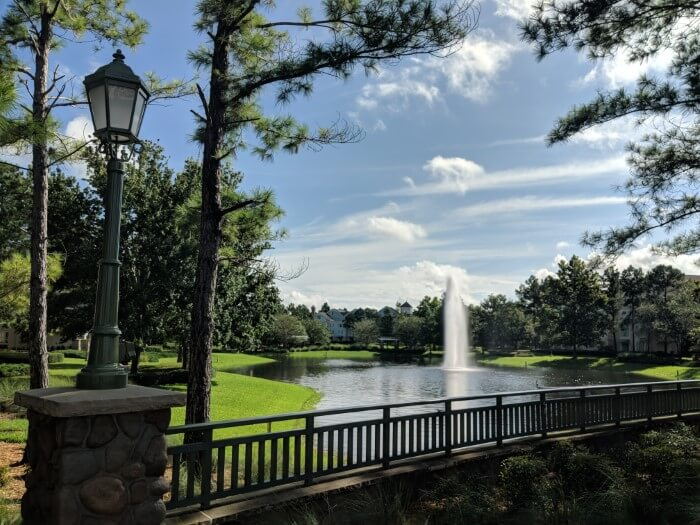 outside at Disney's Saratoga Springs Resort & Spa with lake & fountain