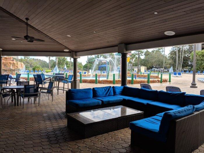 Comfortable seats & tables near pool at Wyndham Disney Springs