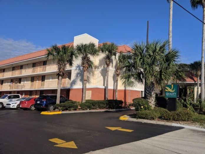 Quality Inn St. Augustine Beach has beautiful palm trees outside
