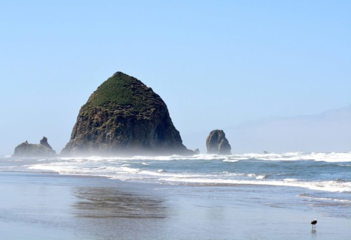 Picture of Haystack rock in Cannon Beach, Oregon. Find out the areas best luxury resorts & how to get a good deal for them.