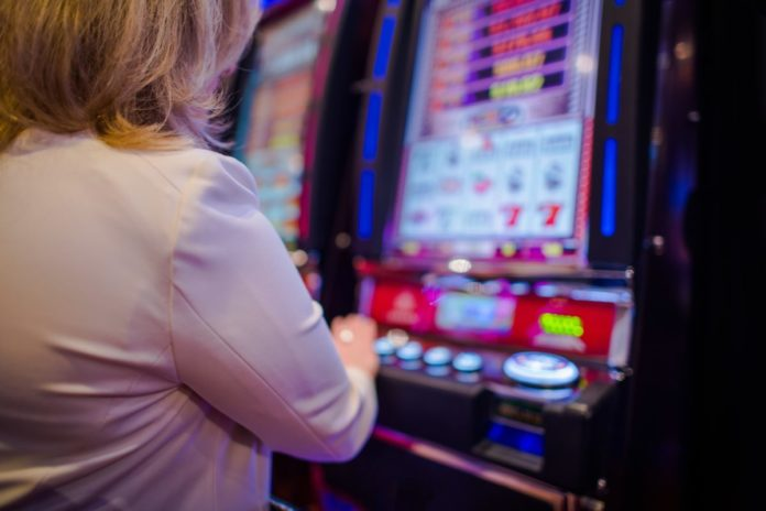 Picture of a woman at a casino. Find out the best Kansas casinos & hotels near them