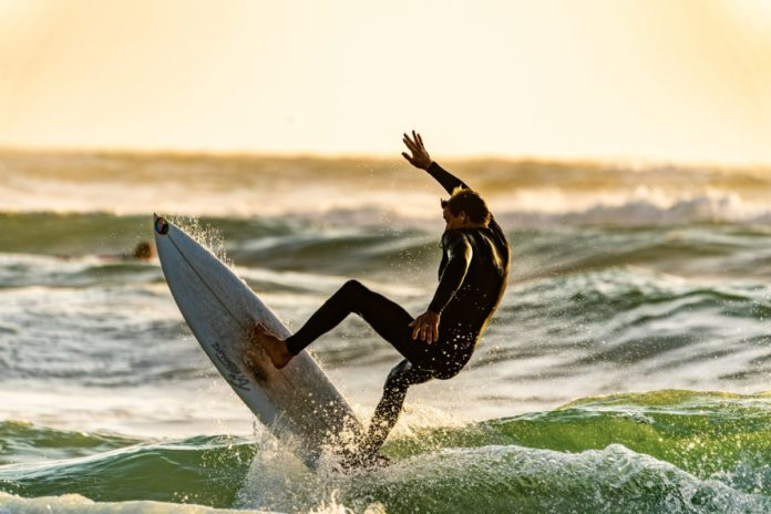 Picture of a man surfing in Pacific Grove, California. Read our travel tips on how to get a good price on the best Pacific Grove hotels