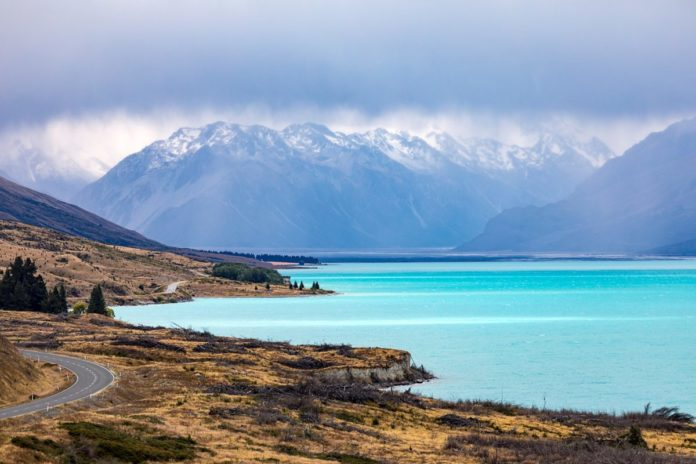 An image of the turquoise Lake Pukaki in New Zealand. Find out how to get a low rate for a nearby hotel