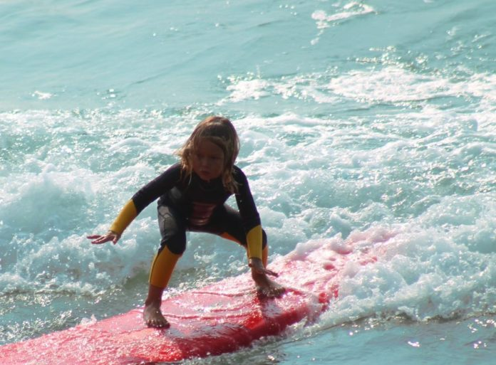 Buy your child a surfboard before your beach vacation