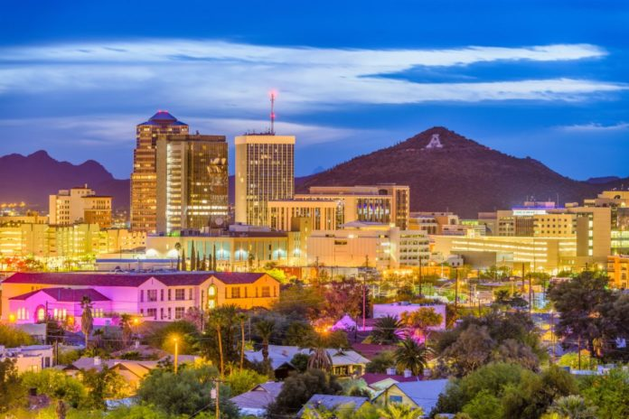 A picture of Tucson, Arizona, USA downtown skyline with Sentinel Peak at dusk. Find out how to get a great deal on Tucson luxury hotels.