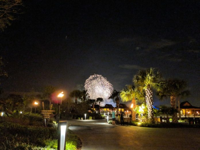 A picture of a view of the Magic Kingdom fireworks from Disney's Polynesian Resort, a big perk of staying at Polynesian.