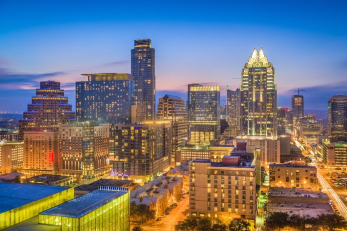 Austin, Texas, USA skyline at dusk. Find out how to get deals on Austin hotels.