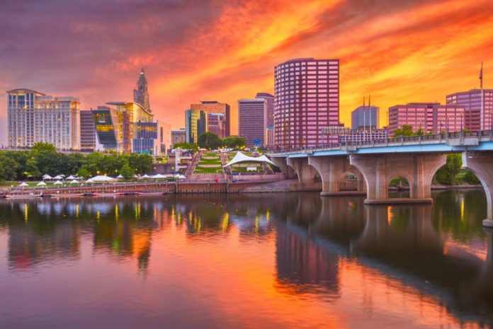 Hartford, Connecticut, USA downtown skyline on the river at dusk. Find out what the best luxury hotels there are