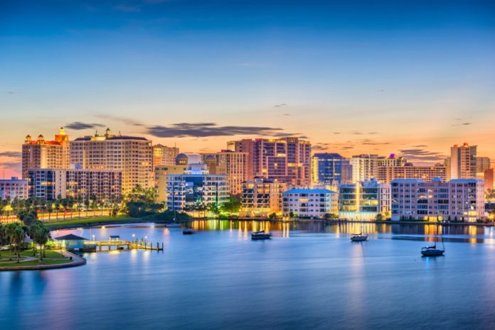 Sarasota, Florida, USA skyline on the bay at dawn. Find out how to get discounted Sarasota hotels.
