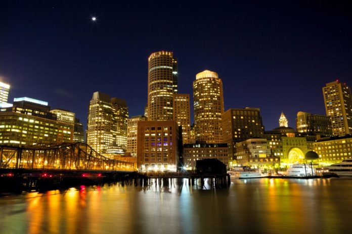 Nighttime view of Boston Harbor, Massachusetts, USA. Find out how to save on a 4th of July weekend cruise there
