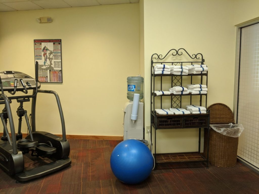 A picture of fitness & yoga equipment available at the workout room at Best Western at Disney World in Orlando Florida