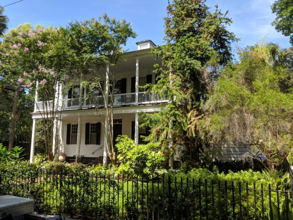 A beautiful home & trees that you'll see during the Charleston Historic District horse & carriage tour.