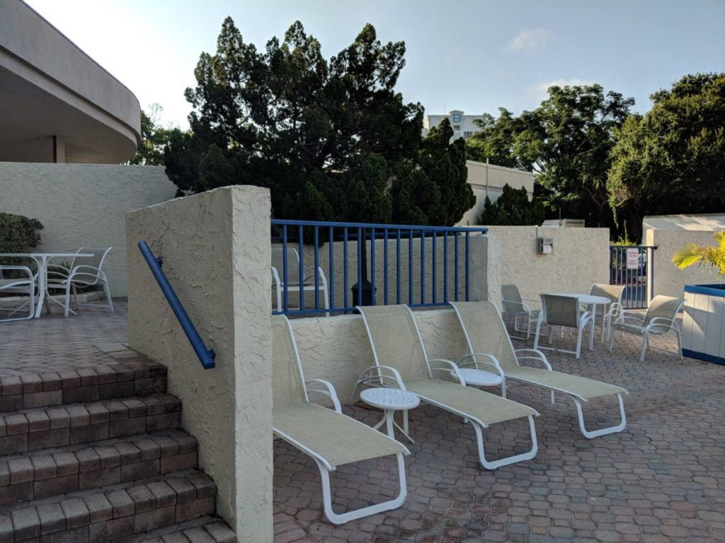 Parents can relax while their kids swim in the pool at Best Western Lake Buena Vista at Walt Disney World Resort in Orlando Florida